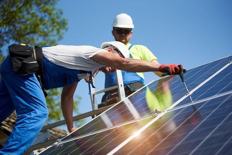 two technicians installing solar panels