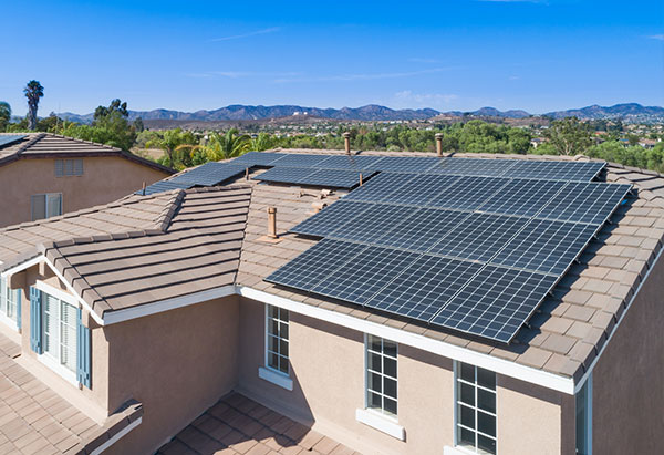 solar panels installed on roof of large house